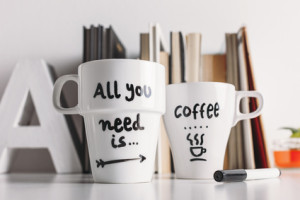 Close up of two white coffee mug with diy decoration.