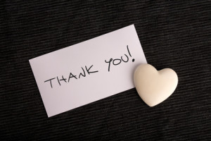 Thank you handwritten on a white card