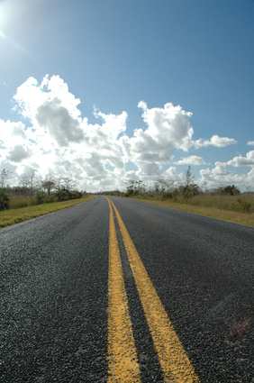 A two lane road runs through the heart of the Florida