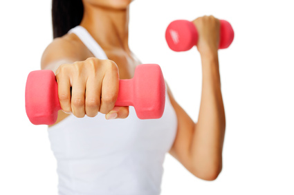 Mixed race woman holding dumbbells