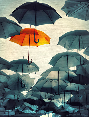 umbrella standing out from the crowd vintage effect photo