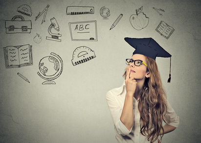 Young beautiful business woman with graduation hat looking up thinking about education isolated on gray wall background